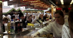 Food stall christmas market Germany Aachen Stock Footage