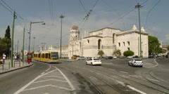 Lisbon, Portugal - Belem Train Passes Jeronimos Monastery. Stock Footage