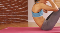 Fit woman doing crunches exercise Stock Footage