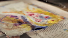 Painting moves with a small brush over a portrait Stock Footage