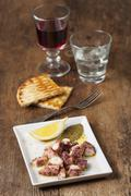 greek starter with wine on wood - stock photo