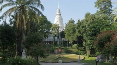 Park at Wat Phnom temple with giant grass clock,Phnom Penh,Cambodia Stock Footage