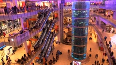 Crowd of people going in a big shopping center near the aquarium with sea fish Stock Footage
