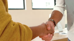 Man and woman shake hands Stock Footage