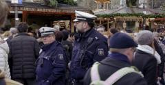 Germany police patrolling Christmas market Stock Footage