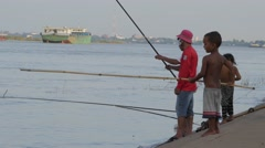 Men fishing with boy try copy,Phnom Penh,Cambodia Stock Footage