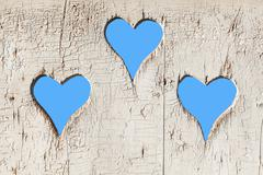 Heart shape look out on wooden door to outhouse. - stock photo