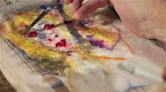 Fast painting moves with a small brush on a portrait Stock Footage