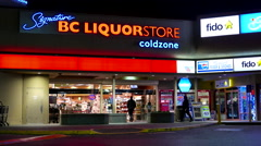 Outdoor shot of BC liquor store at night - stock footage