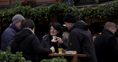Group drinking mulled wine Christmas Market Stock Footage