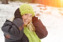 Attractive Woman Having Fun in the Snow on a Winter Day. Stock Photos