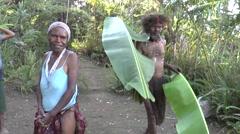 Papua New Guinean man bring leaves to prepare mumu - stock footage