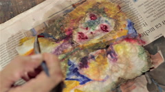 Painting with red over a watercolor portrait Stock Footage