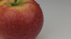 Extreme closeup red apple  in drops of dew rotates on its axis - stock footage