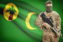 Soldier holding machine gun with national flag on background - Cocos (Keeling - stock photo