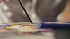 Painting process over a watercolor portrait Stock Footage