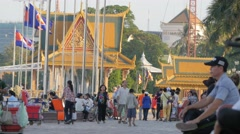 People enjoying riverside walk,Phnom Penh,Cambodia Stock Footage