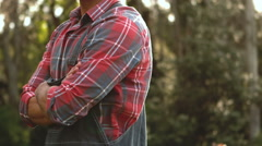 Serious gardener man with arms crossed Stock Footage