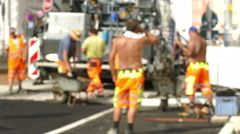 4K UHD Anonymous Construction workers doing Roadworks in hot sun - stock footage