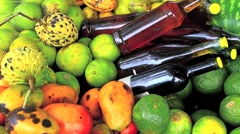 Variety of tropical fruits and bottles of molasses Stock Footage