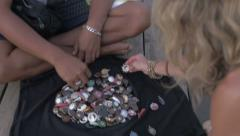 A young woman buying a pendant as a souvenir from a street vendor Stock Footage