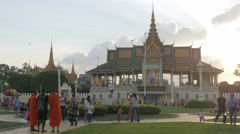 People and monks enjoying Royal palace park,Phnom Penh,Cambodia Stock Footage