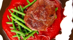 Beef meat on red sauce Stock Footage