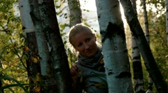 Woman among birches Stock Footage