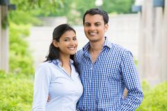 Closeup portrait, attractive wealthy successful couple in blue shirt and stri - stock photo
