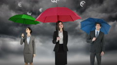 Composite image of businessman and businesswoman holding an umbrella - stock footage