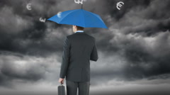 Rear view of businessman holding umbrella Stock Footage