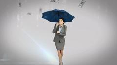 Businesswoman standing under umbrella Stock Footage