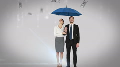 Stock Video Footage of Business people standing under umbrella