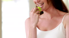 Happy young woman eating salad Stock Footage