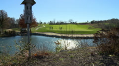 Golf course birdhouse and lake Stock Footage