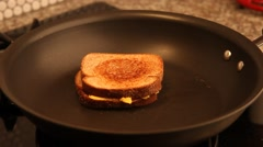 Flipping over a Grilled Cheese. Stock Footage