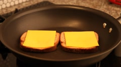 Cooking a grilled cheese sandwich. Stock Footage