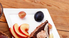 Slice of chocolate cream brownie cake with white chocolate and h Stock Footage