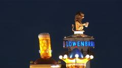 4K UHD TL Skyline Oktoberfest Fairground Lowenbrau Logo Beer Glass German Munich Stock Footage