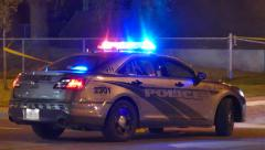 Grey stealth police car with strobe lights flashing Stock Footage