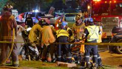 Toronto Rescue teams moving injured passenger on gurney Stock Footage