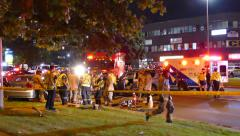 Rescue Teams transporting an  Injured Victim into the Ambulance - stock footage