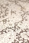 White Lace Table Cloth Background - stock photo