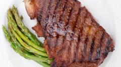 Medium roast beef fillet asparagus served on white plate Stock Footage