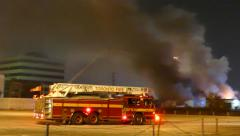 Ladder Truck arriving on the Scene of a building Fire Stock Footage