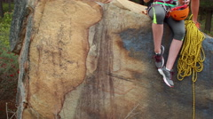Smiling couple preparing themselves to rock climb Stock Footage