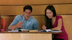 Classmates studying in library Stock Footage