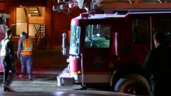 Firetruck stuck in hole after road collapse - stock footage