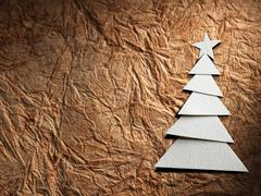 Christmas tree cut out from paper Stock Photos