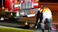 Tow Truck Drivers Installing hooks on firetruck Stock Footage